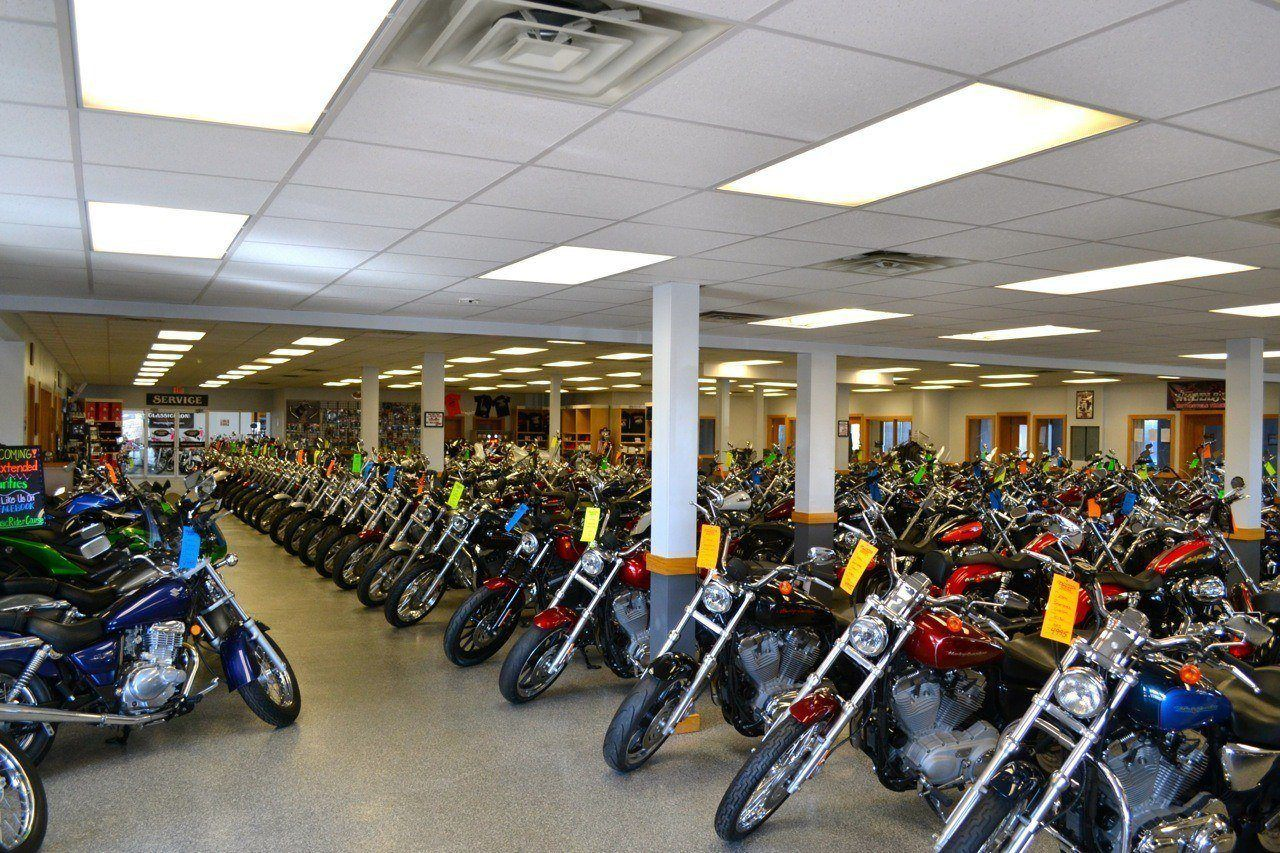 Rows of motorcycles on the showroom floor